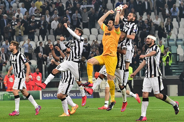 Juventus players celebrate at the end of the UEFA Champions League semi-final first leg football match Juventus vs Real Madrid on May 5, 2015 at the Juventus stadium in Turin. Juventus won 2-1. AFP PHOTO / GIUSEPPE CACACE (Photo credit should read GIUSEPPE CACACE/AFP/Getty Images)